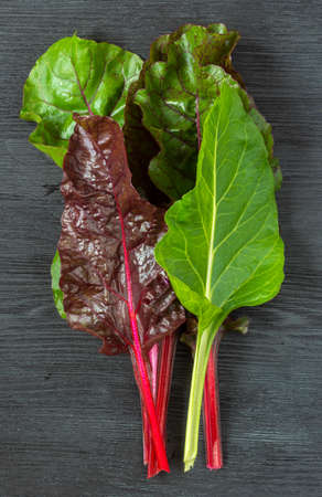 Chard leaves on a wooden table. Farming harvest season, healthy eating