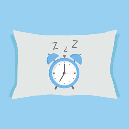 Alarm clock sleeping on a pillow on a blue background