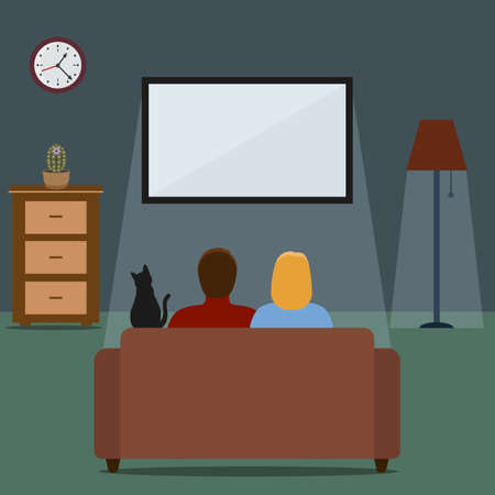 Young couple watching a movie.