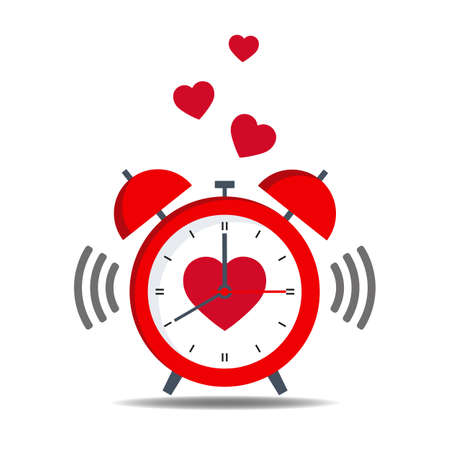 red alarm clock with heart