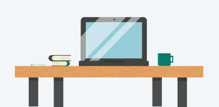 A laptop on the table with books and a mug for use in online education