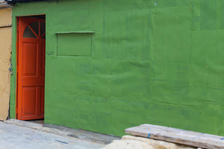 red door: Red door and green wall