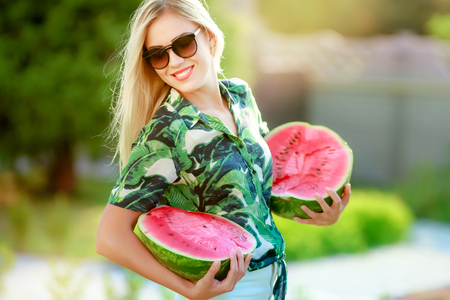Beautiful happy girl with slice of ripe water-melon.