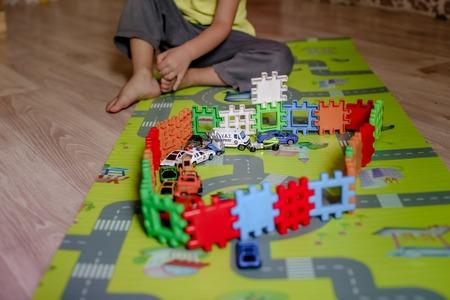 A Creative kindergarten kids build a block tower Фото со стока