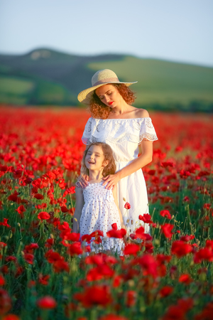 Mother and daughter in poppy field Royalty Free Stock Images.