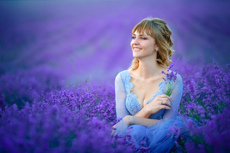 Beautiful Bride in wedding day in lavender field. Newlywed woman in lavender flowers