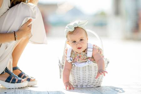 Cute tiny newborn baby princess in a ballet skirt with a bow on a basket with plaid. Soft tones. Adorable newborn infant girl stock image Stockfoto