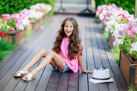 A Young happy girl at the park on a summer day. Stok Fotoğraf