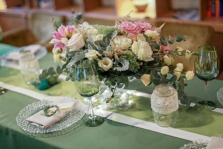 Festive wedding table, decorated with sweets and drinks. Stock Photo