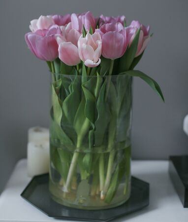 Bouquet of pink tulips in a vase, close up.