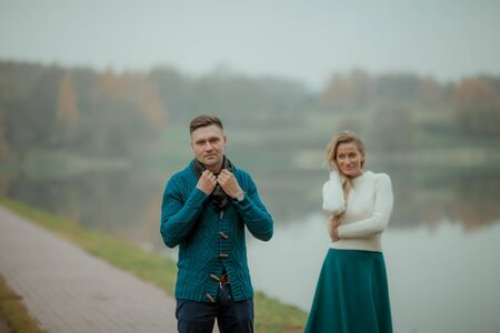 A couple of two a strong man and an elegant woman recently married on their honeymoon. Stok Fotoğraf