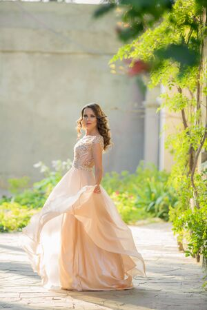 Women 28-35 years old in a public park in a romantic old-style dress. Stok Fotoğraf