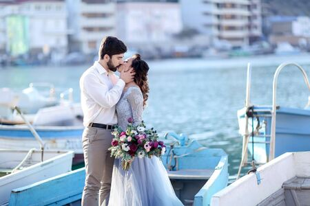 Bride and groom wedding on pier with boats on the sea marine Stok Fotoğraf