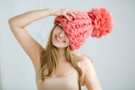 Fashion model dressed in natural knitted dense viscous things made of natural wool.