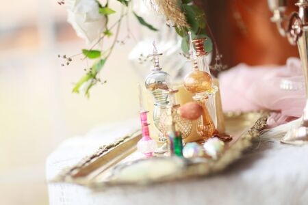 Glass bottles of perfume and spices on the table