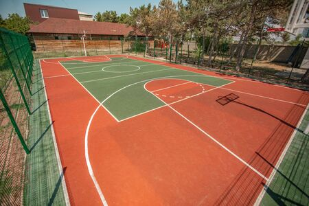 Basketball ground in a public park. Sports basketball court from different angles without people
