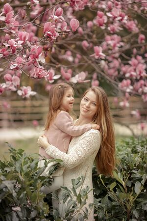 Young woman with long beautiful hair and baby.