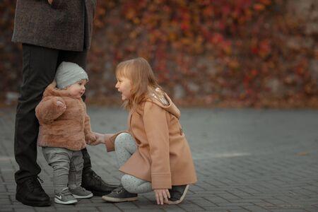 Two children communicate with each other on an autumn walk Standard-Bild