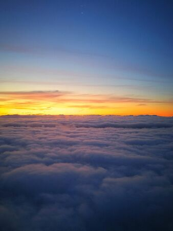 The suns rays above the horizon from the clouds. Photos from the aircrafts ilumyator. Atmospheric photograph from the stratosphere