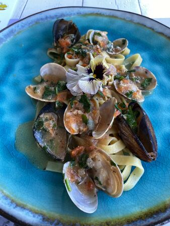 Mediterranean mussels and seafood combined with Italian pasta.