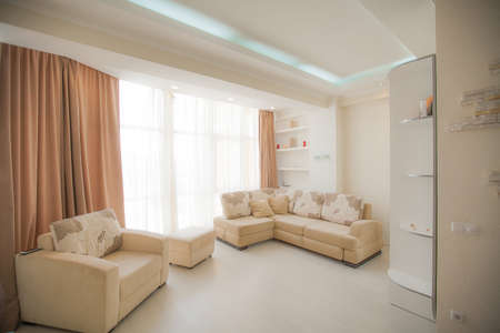 The interior of a modern apartment after renovation. Presentation of the apartment in light warm tones