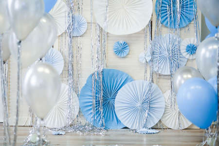 The concept of festive decorations in blue with balloons. 免版税图像