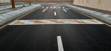 Renovated road with bright new road markings. 免版税图像