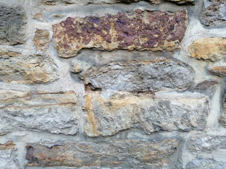 Textured background of the old stone wall.