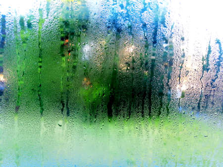 raindrops slide down the window glass, forming abstract figures Stok Fotoğraf