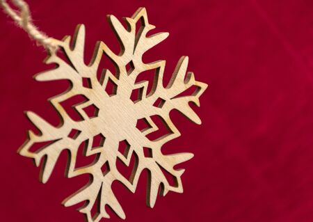 cymbol: snowflake hanging on a rope, red background, new year, Christmas, decor, decoration