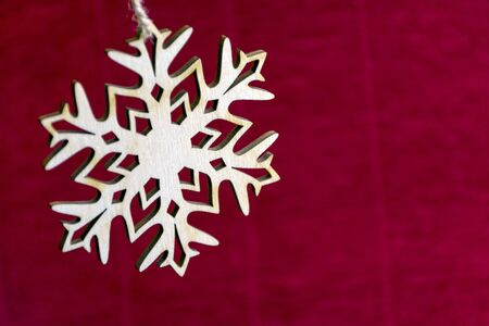 cymbol: snowflake on red background, new year, Christmas, holiday, celebration, winter