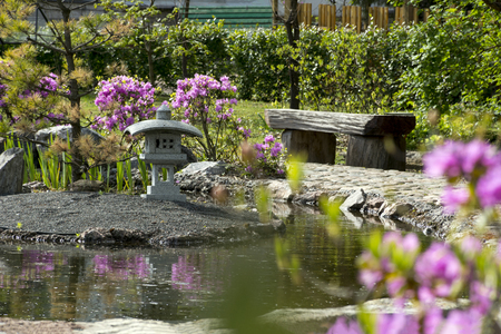 Garden in the japanese style bench from wood pond shrubs with garden in the japanese style bench from wood pond shrubs with pink flowers mightylinksfo