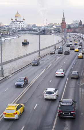 Moscow, embankment of the Moscow river, cars, road, traffic,  river, sunset, view, city, Christian Church of the Savior