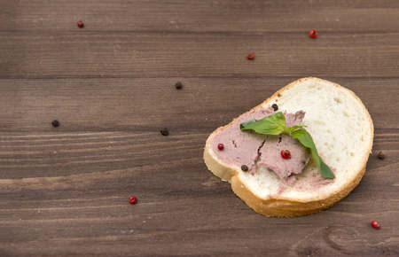 sandwich with meat chicken pate, Basil and spices on wooden background
