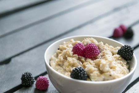 oatmeal with BlackBerry, porridge with berries on a wooden background