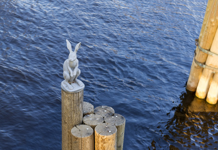 landmark, metal hare sitting on wooden stilts in the middle of the Neva river in St. Petersburg, attraction