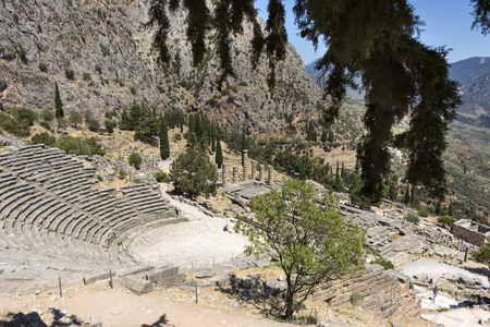 view of the ancient temple complex in Delphi from the mountain, Greece, temple of Apollo, mountain landscape, ruins of the ancient amphitheater