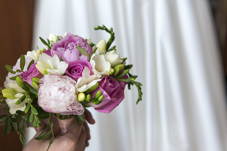 bouquet of pink roses and peonies on the background of white wedding dress, flowers, Reklamní fotografie - 122781180