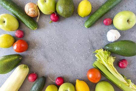 vegetables, fruits, cucumbers, apples, zucchini, celery, measuring tape, lemon, radish, lime, avocado, salt, green Apple,  tomato, onion ,garlic, fresh vegetables on grey background,