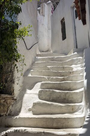 white stone staircase along buildings in the Greek city, steps,