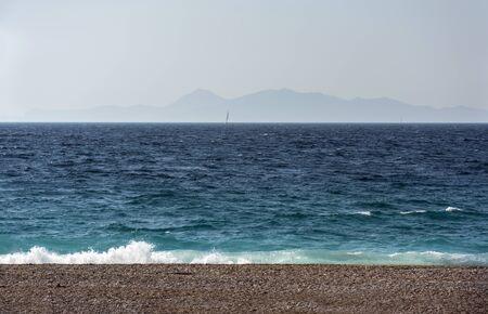 sea coast ,Aegean sea, Greece, sea on a Sunny day ,Islands on the horizon, sail in the sea Reklamní fotografie