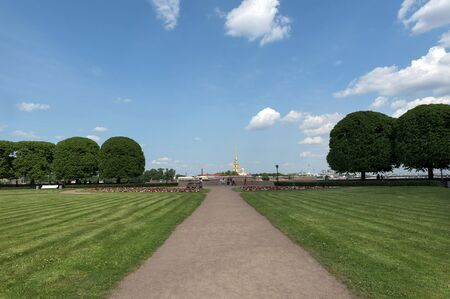 view from Vasilevsky island at Peter and Paul fortress,  view of St. Petersburg in the summer Sunny day,  green lawn blue sky with cloud, Reklamní fotografie
