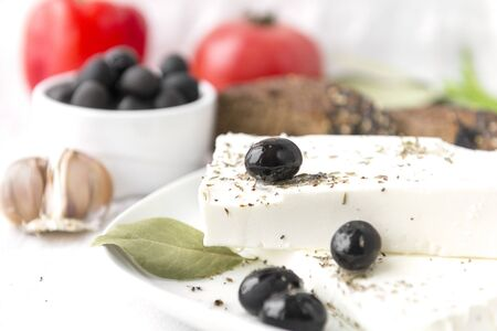 Greek feta cheese with spices and olives Reklamní fotografie