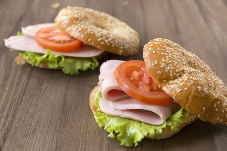 2 sandwiches with ham, tomato and lettuce, sandwich on a round bun with sesame seeds,  Reklamní fotografie