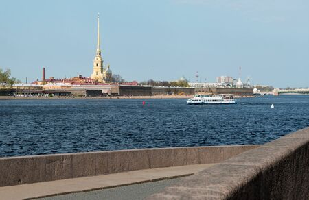 pleasure boat on the Neva river in St. Petersburg in the summer, a view of the Peter and Paul fortress against the blue sky, Reklamní fotografie