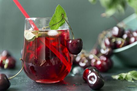 cherries , 1 glass with lemonade from cherries with mint green and red shades