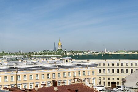 roofs of buildings in St. Petersburg on a Sunny day, the Golden dome of the Cathedral, the blue sky