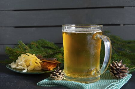 1 mug  light barley beer, with rings of squid and slices of smoked fish ,  fir branches, fir cones Фото со стока - 130127269