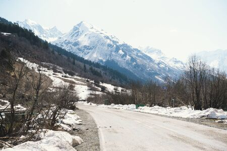 road in the Caucasus mountains in winter, snowy peaks and slopes Stok Fotoğraf