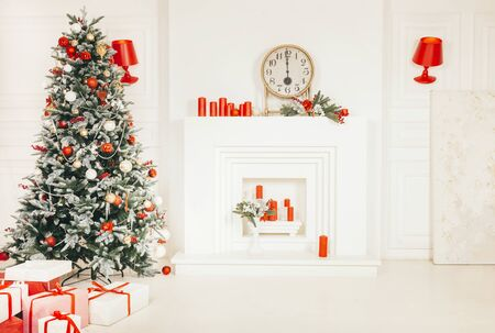 white room with kainom and decorated with Christmas fir tree and gifts, interior